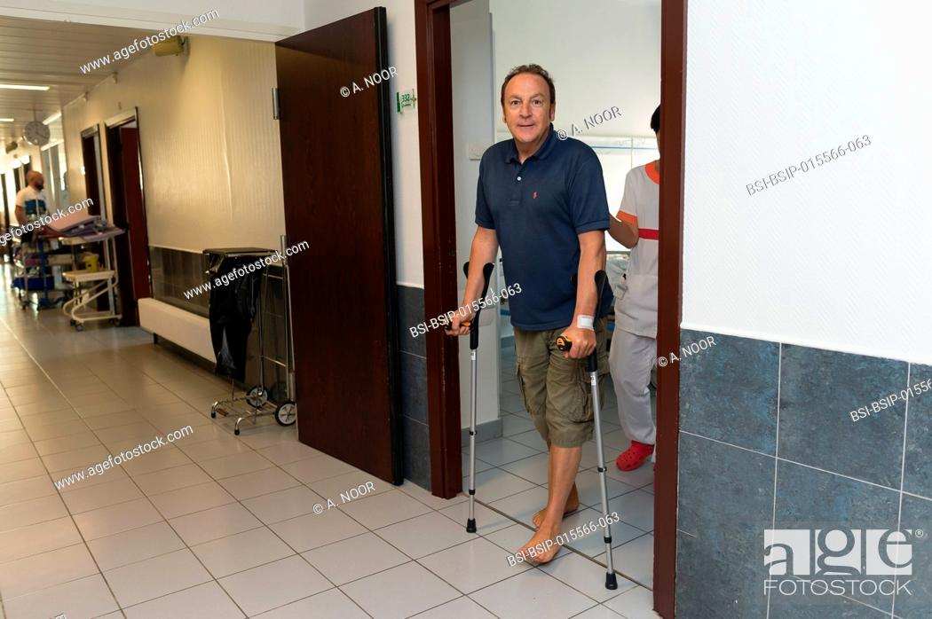 Stock Photo: Reportage in the orthopedic surgery service in Saint George Clinic, Nice, France. Fitting a dual mobility hip prosthesis in a patient suffering from.