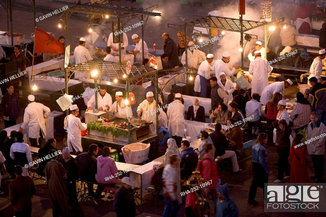 Stock Photo: Elevated view over Djemaa el-Fna in the evening when the square is filled with food stalls, Marrakech Marrakesh, Morocco, North Africa, Africa.