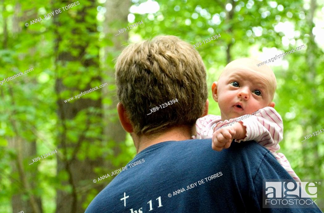 Stock Photo: Father with baby in forest.