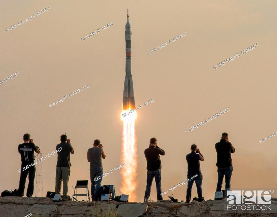 Stock Photo: The Soyuz MS-01 spacecraft launches from the Baikonur Cosmodrome with Expedition 48-49 crewmembers Kate Rubins of NASA, Anatoly Ivanishin of Roscosmos and.