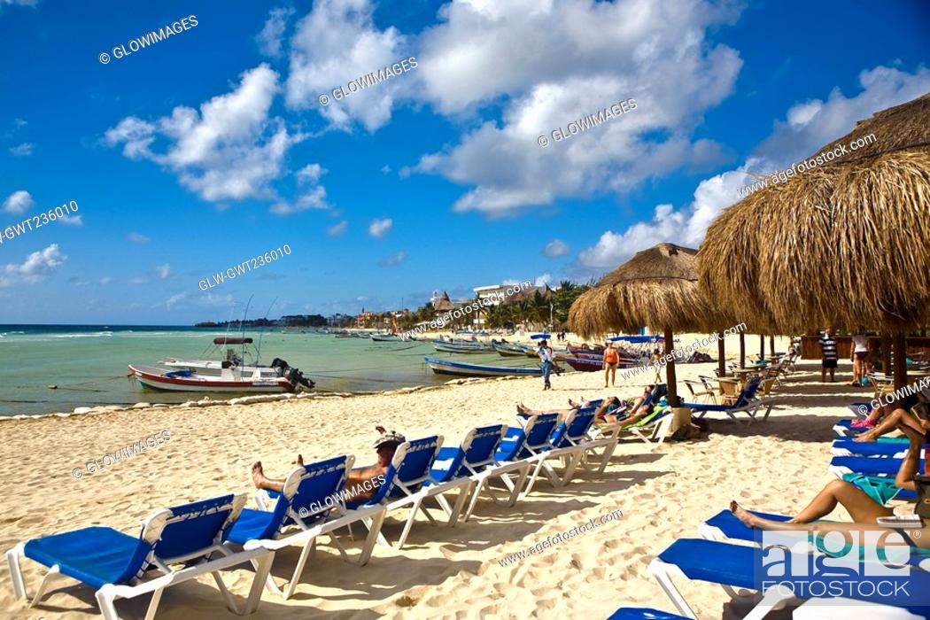 Stock Photo: Tourist lying on lounge chairs on the beach, Playa Del Carmen, Quintana Roo, Mexico.