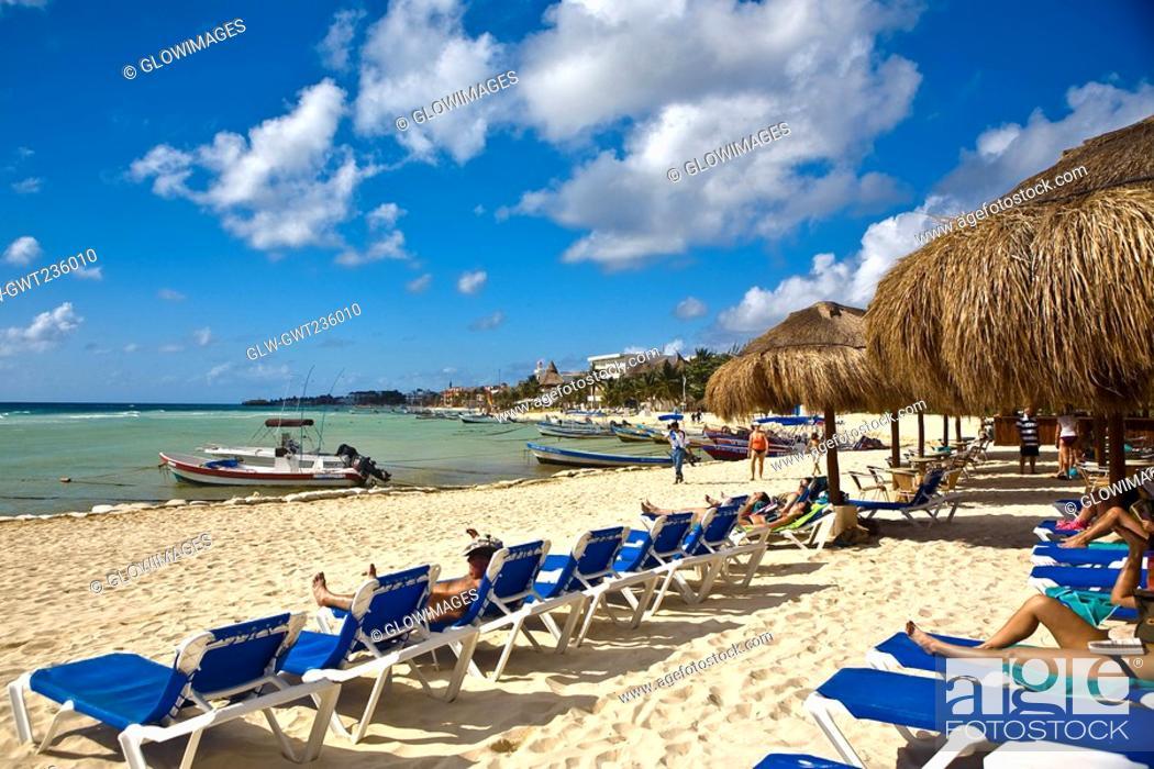 Stock Photo: Tourist lying on lounge chairs on the beach, Playa Del Carmen, Quintana Roo, Mexico.