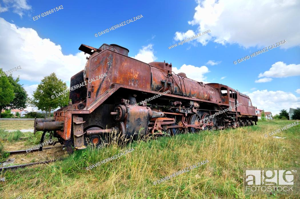Stock Photo: old ruined steam locomotive.