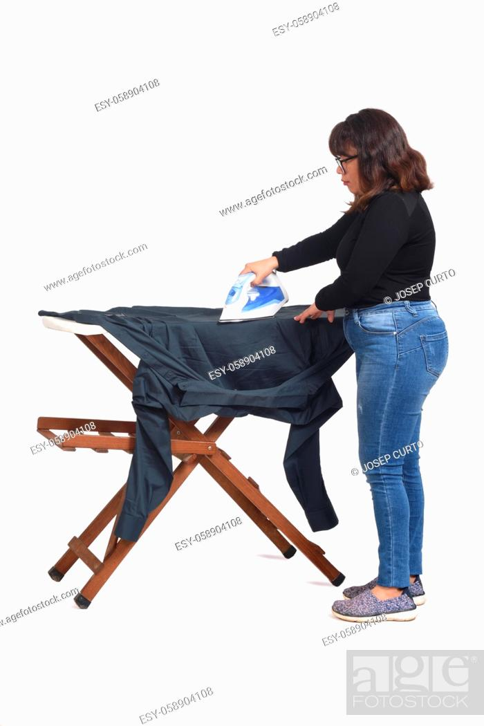 Stock Photo: rear view of a latin woman ironing on white background.