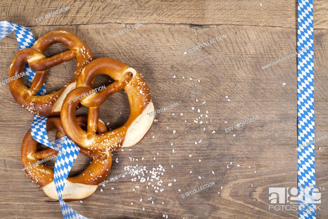 Stock Photo: Oktoberfest pretzel on wooden table (copy space).