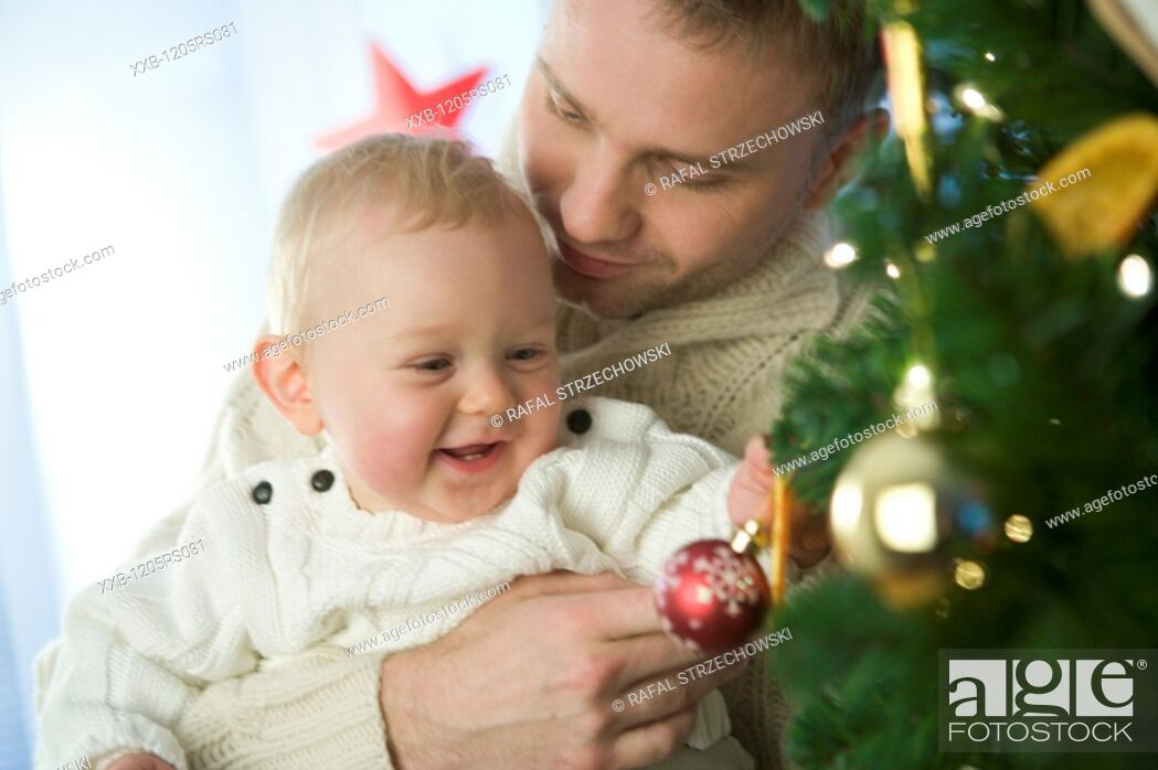 Stock Photo: christmas portrait of father and baby.