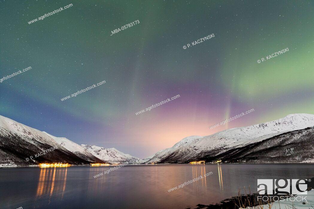 Stock Photo: Aurora borealis above a fjord in wintry landscape, Tromsö, Troms, Norway, North Norway, North Scandinavia.