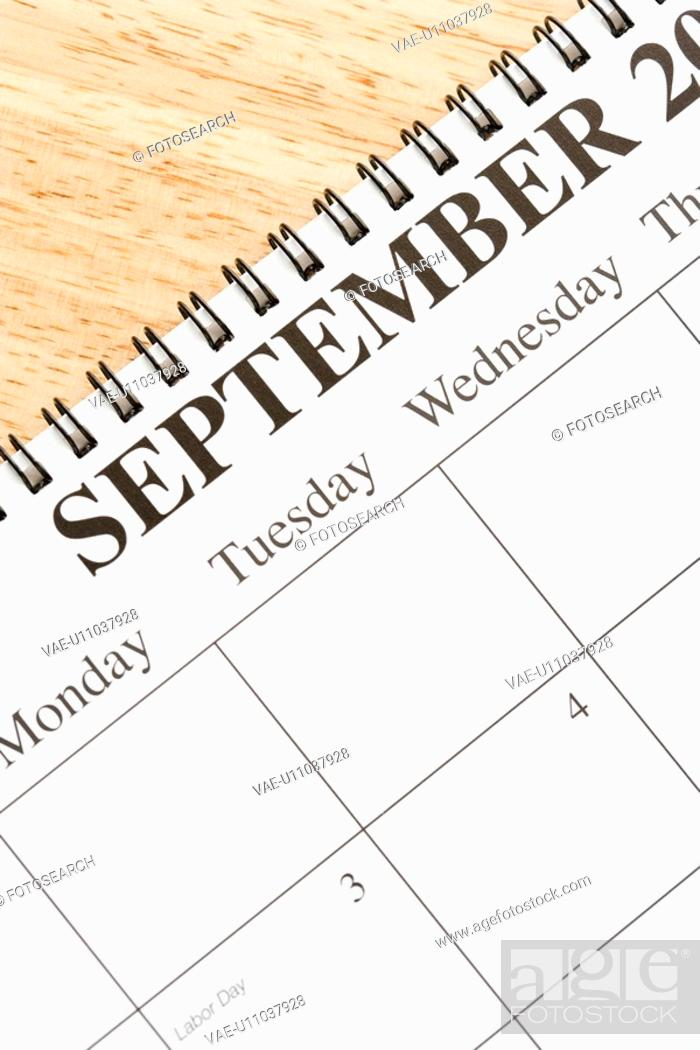 Stock Photo: Close up of spiral bound calendar displaying month of September.