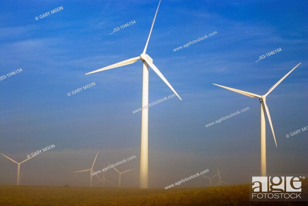 Stock Photo: Wind turbines at dawn with ground fog, Judith Gap, Montana USA.