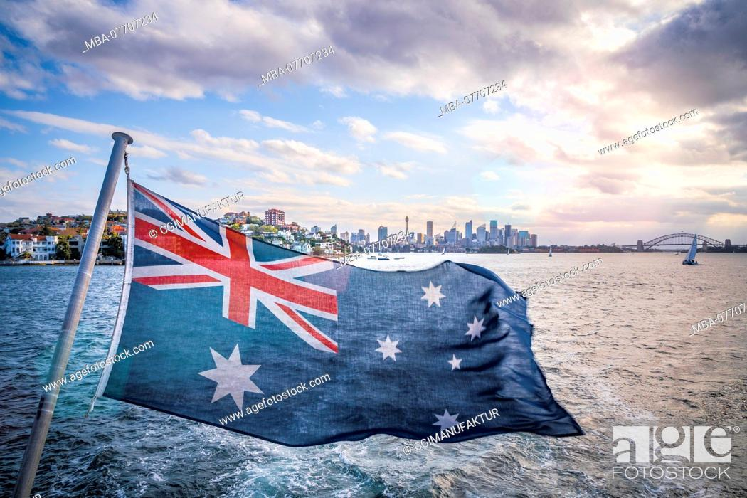 Stock Photo: Opera and Sydney Harbour Bridge seen from a ship, Australian flag in the foreground.