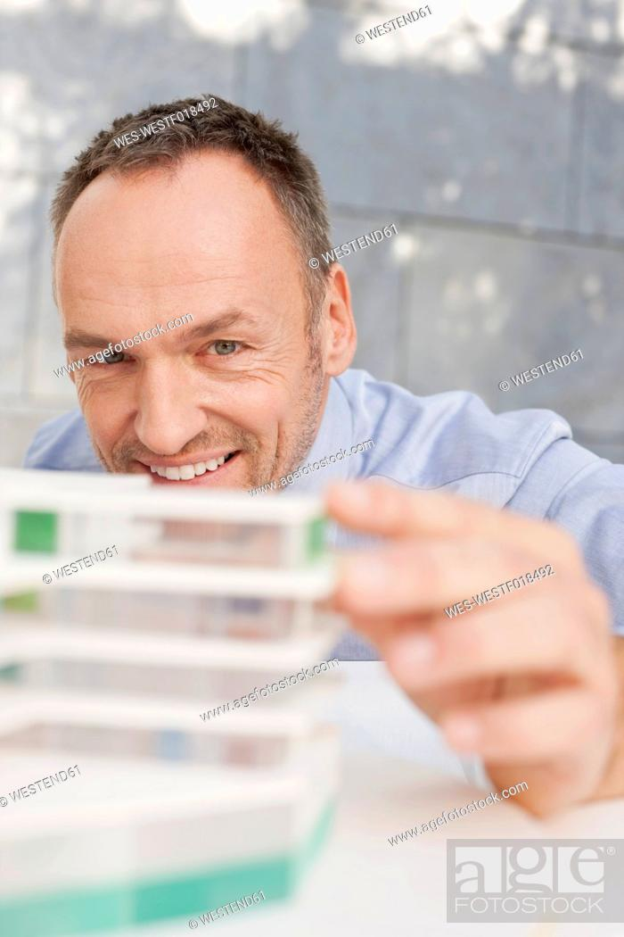 Stock Photo: Germany, Leipzig, Businessman with architectural model.