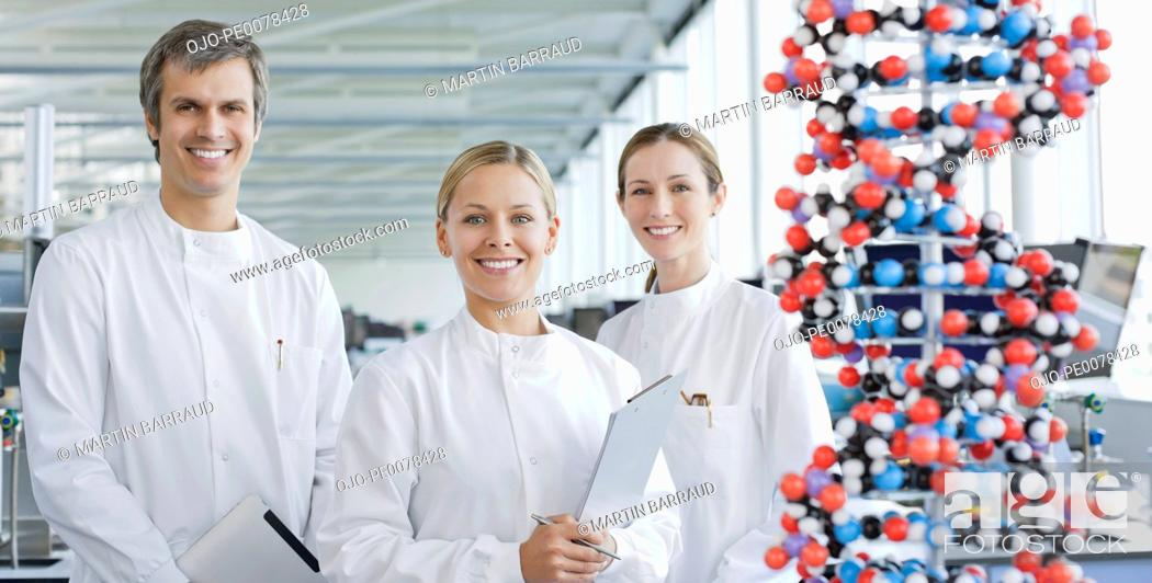 Stock Photo: Scientists with molecular model in lab.
