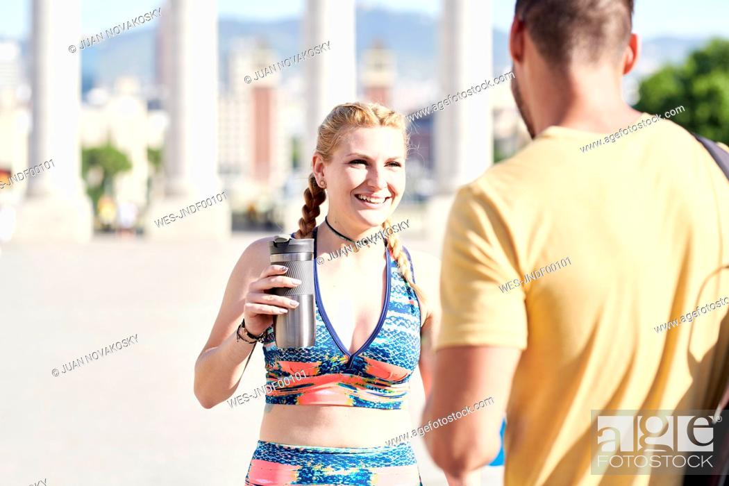 Stock Photo: Happy woman with man finishing workout outdoors in the city.