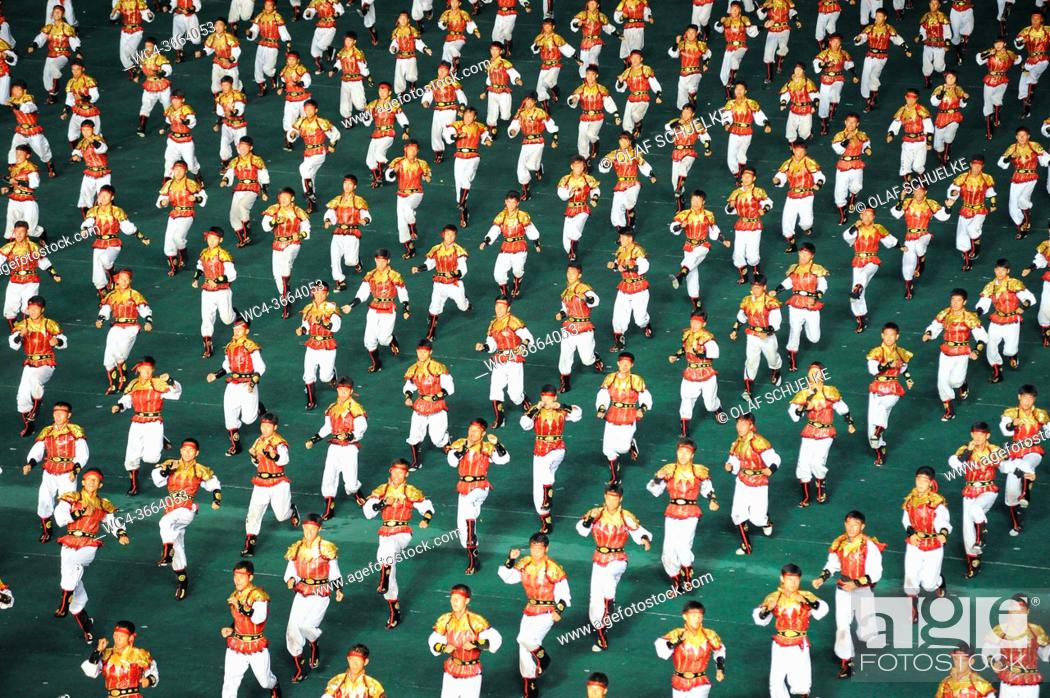 Stock Photo: Pyongyang, North Korea, Asia - Mass choreography and performance of Taekwondo fighters at the May Day Stadium during the Arirang Mass Games Festival in the.