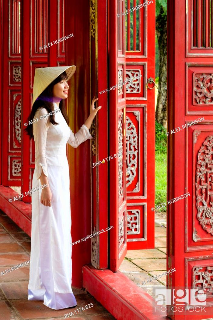 Stock Photo: A woman in a traditional Ao Dai dress and Non La conical hat in the Forbidden Purple City of Hue, UNESCO World Heritage Site, Thua Thien Hue, Vietnam, Indochina.