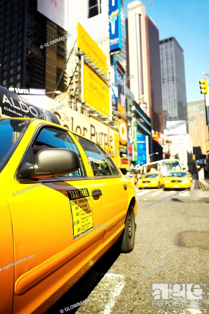 Stock Photo: Yellow taxi on a road, Times Square, Manhattan, New York City, New York State, USA.