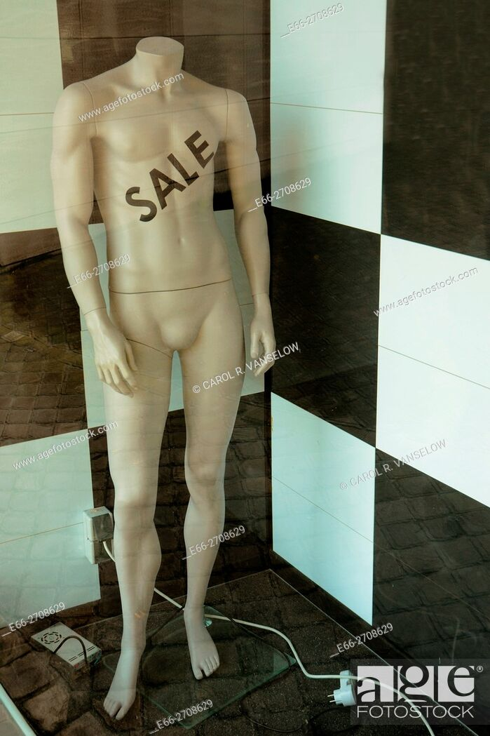 Stock Photo: Male mannequin in shop window. Sale is written on his chest.