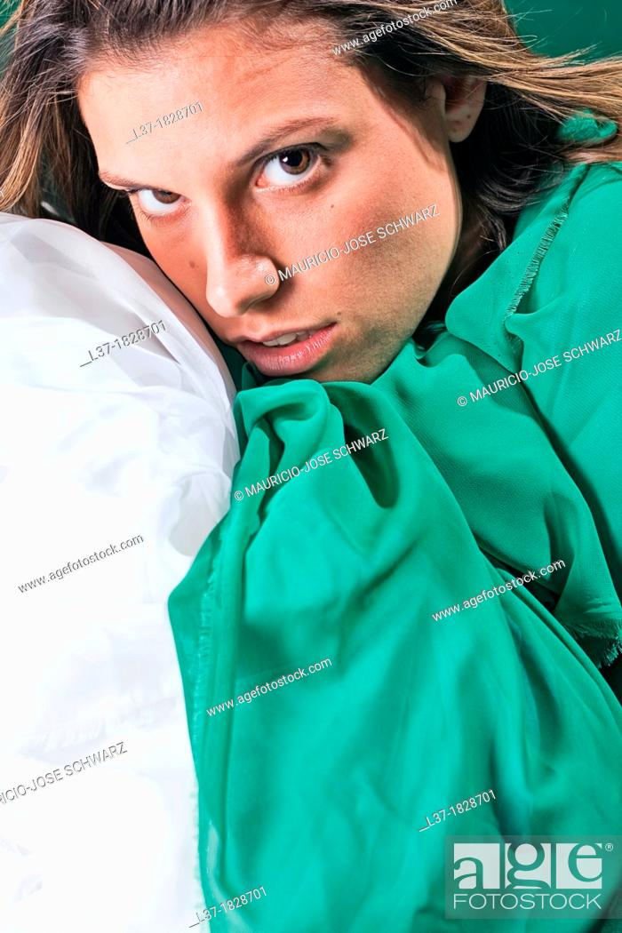 Stock Photo: Young woman wrapped in green and white cloth.