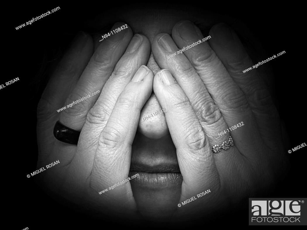 Stock Photo: Woman covering itself the eyes.