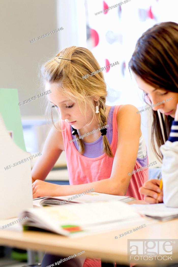 Stock Photo: Schoolgirls in classroom.