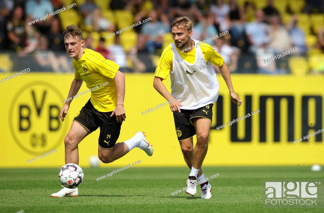 Stock Photo: firo: 09.07.2018, football, 1.Bundesliga, season 2018/2019, BVB, Borussia Dortmund, training, opening training, Jacob Bruun Larsen versus Marcel SCHMELZER  .