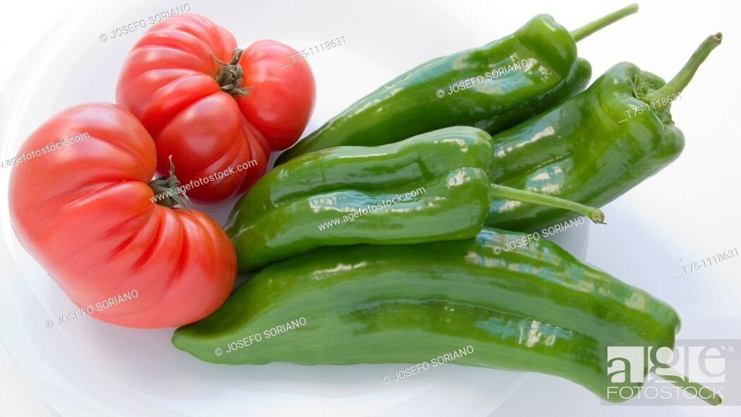 Stock Photo: Raff tomatoes and italian peppers.