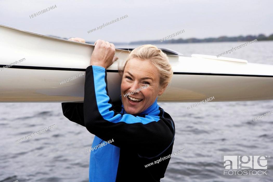 Stock Photo: Woman Holding Kayak.