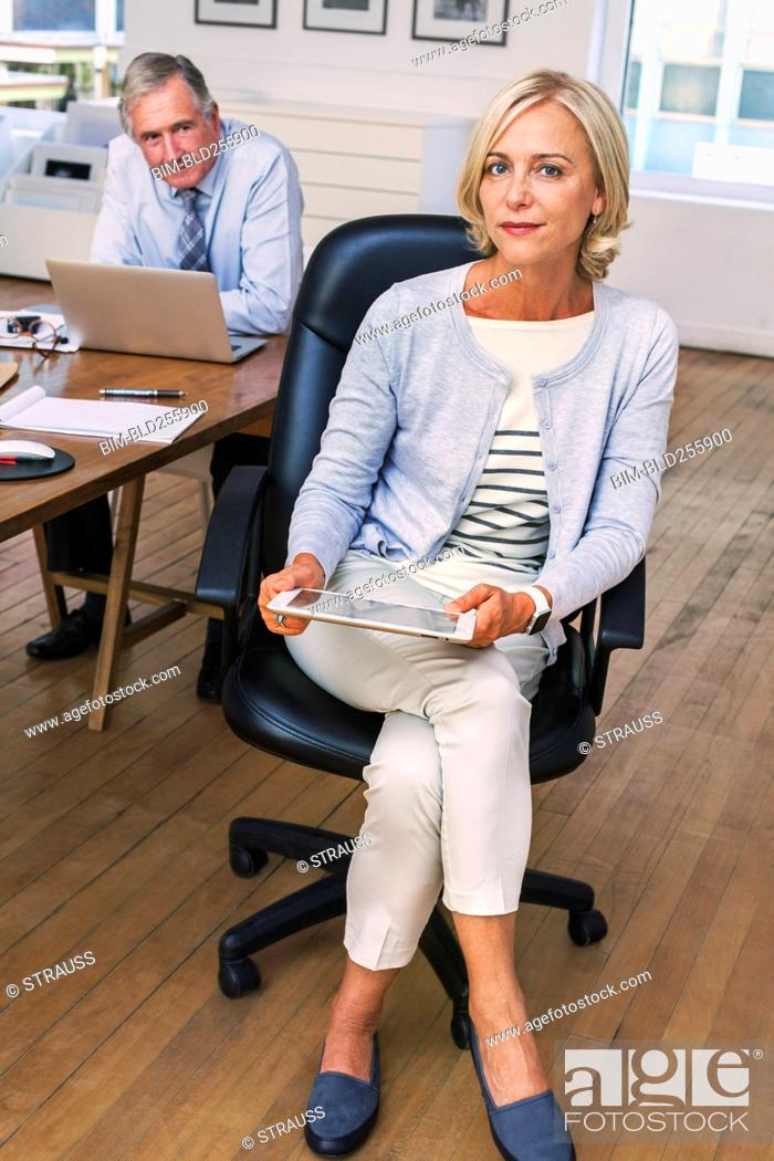 Stock Photo: Portrait of confident Caucasian businesswoman holding digital tablet.
