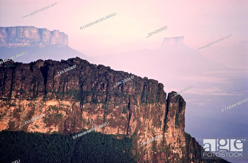 Stock Photo: Aerial view of the Southeastern wall at sunrise of Aparaman-tepuy in tne Gran Sabana, Auyantepuy and Wei-tepuy in the background.