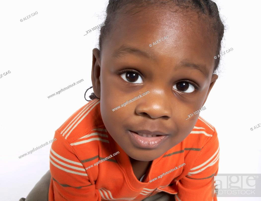Stock Photo: Young Boy Looking into Camera.