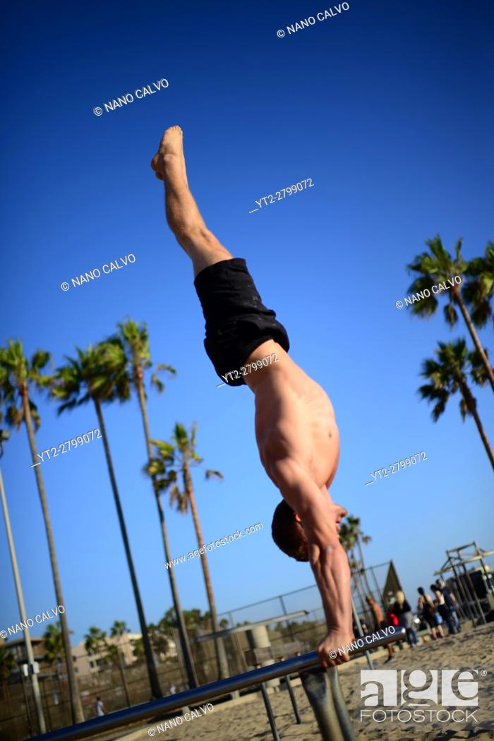 Stock Photo: Finnish athlete and coach, Aaro Helander, practicing in Venice Beach Calisthenics park, Los Angeles.