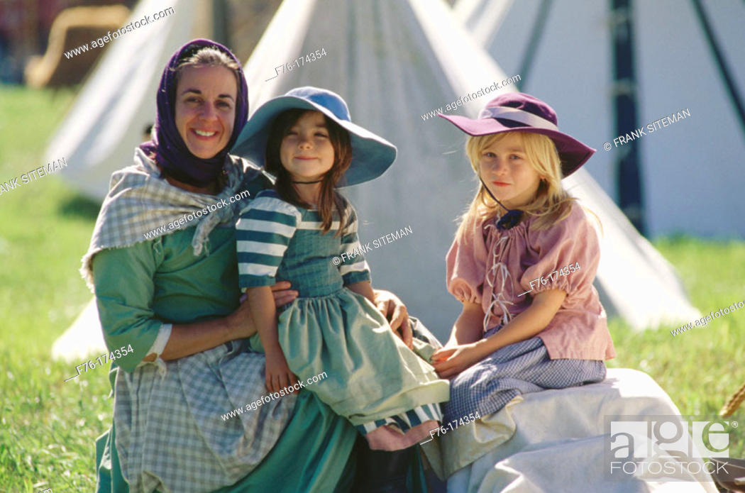 Stock Photo: Family in 1700's period dress. Jefferson. New Hampshire. USA.