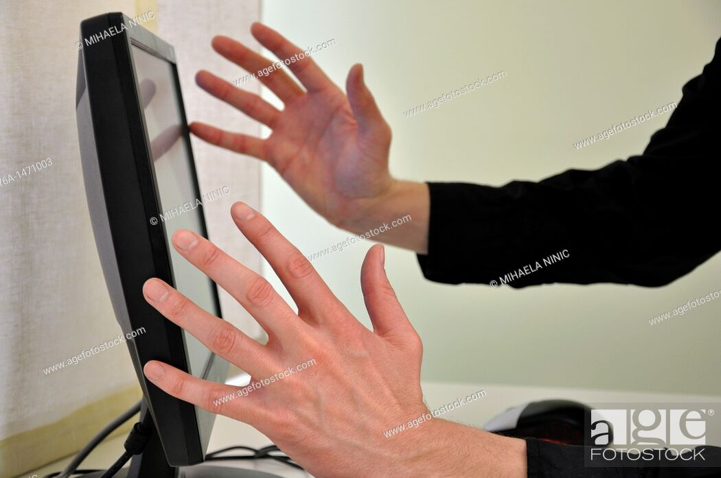 Stock Photo: Frustrated businessman in front of computer focus on hands.