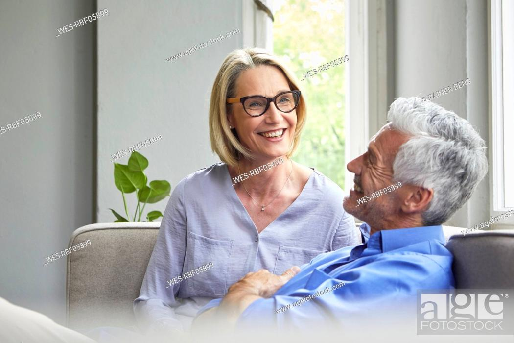 Stock Photo: Happy mature couple on couch at home.