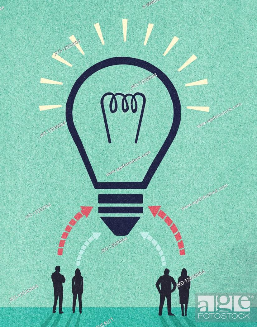 Stock Photo: Ideas from business people forming huge light bulb.