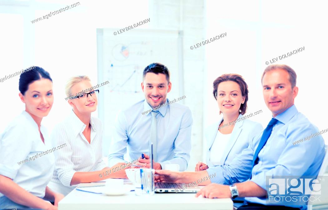 Stock Photo: friendly business team having meeting in office.