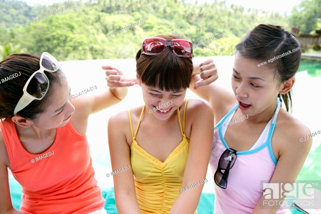 Stock Photo: View of playful young women.
