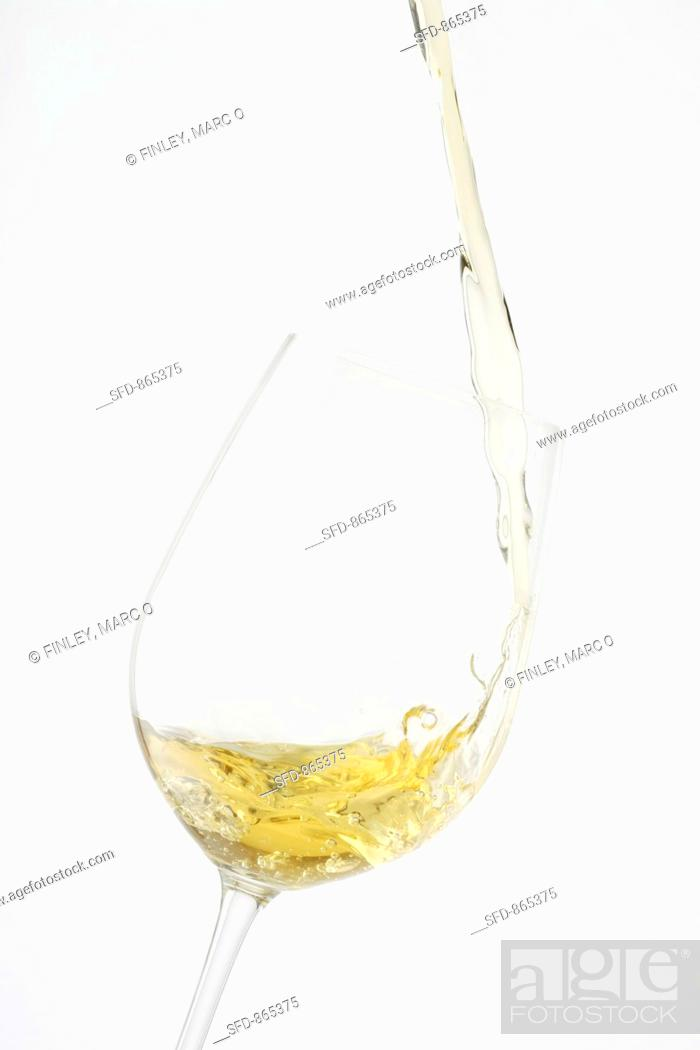 Stock Photo: Pouring white wine into a glass.