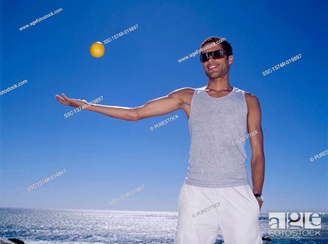 Stock Photo: Young man playing with a ball.