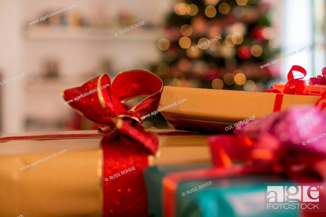 Stock Photo: Close up of three christmas gifts with ribbons.