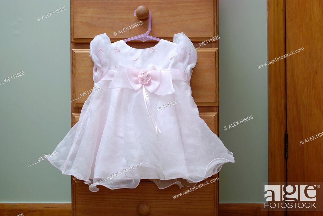 Photo de stock: Pretty pink party dress for a baby girl.