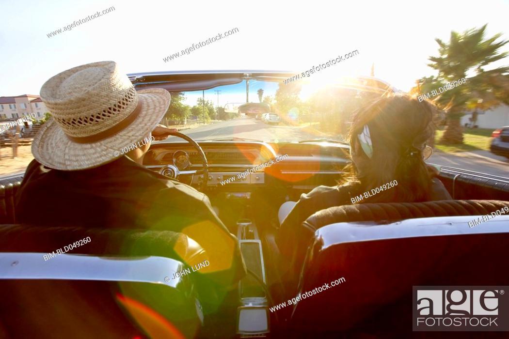 Stock Photo: Hispanic couple driving convertible.