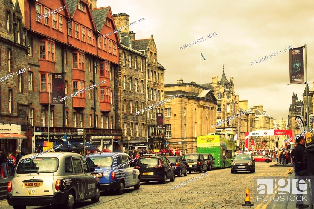 Stock Photo: Cars and taxi cabs in the Old Town, Royal Mile, Edinburgh during Fringe Festival, Summer 2015, Scotland, United Kingdom.