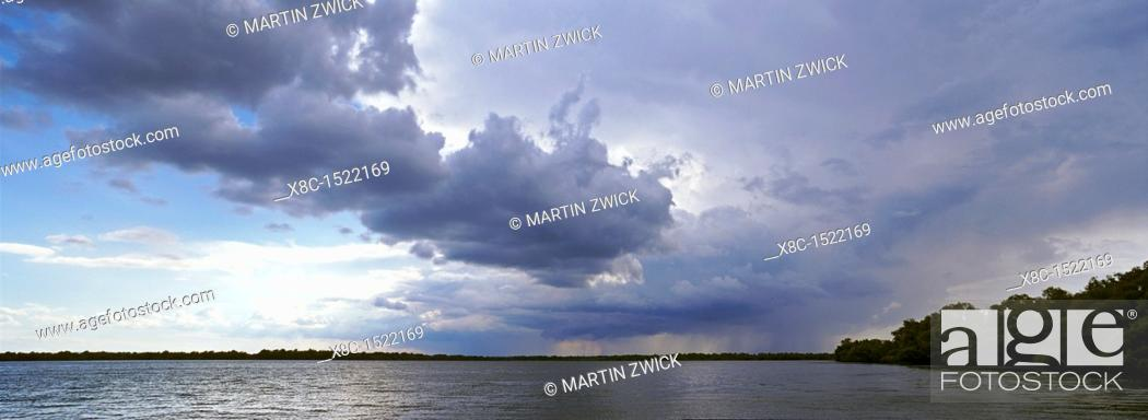 Stock Photo: Panorama of lakes and channels in the Danube Delta, romania, thunderstorm clouds form in the air, which is full of moisture from the huge evaporation surface of.