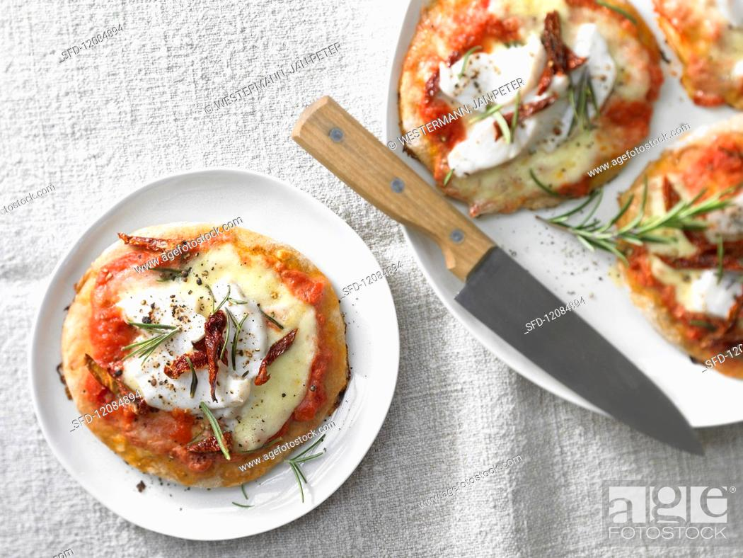 Stock Photo: Mini spelt pizzas with pike-perch fillet and tomato strips.