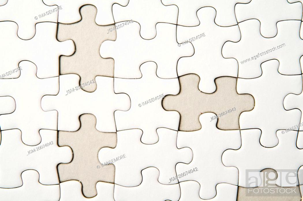 Stock Photo: Jigsaw Pieces, four piece missing.