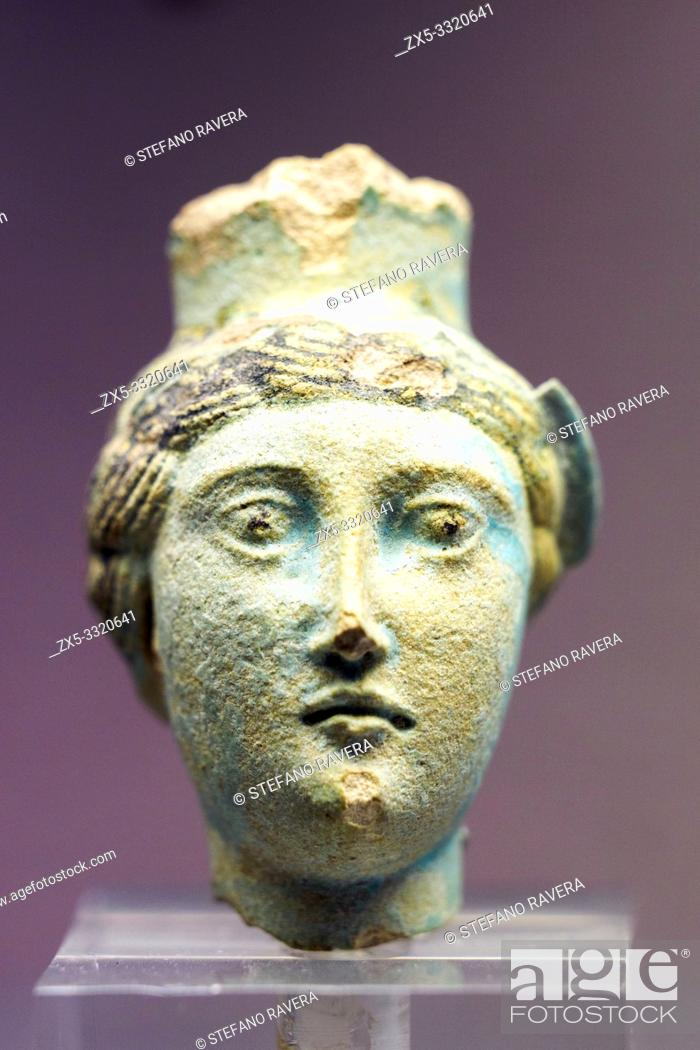 Stock Photo: Spout of a faience vessel in the form of an early Ptolemaic queen, prehaps Berenike II. Made in Egypt during the 3rd century BC.