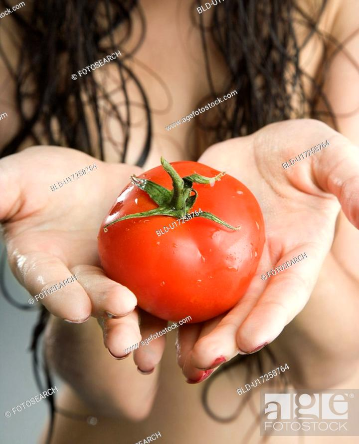 Stock Photo: Close up of a topless woman holding a tomato.