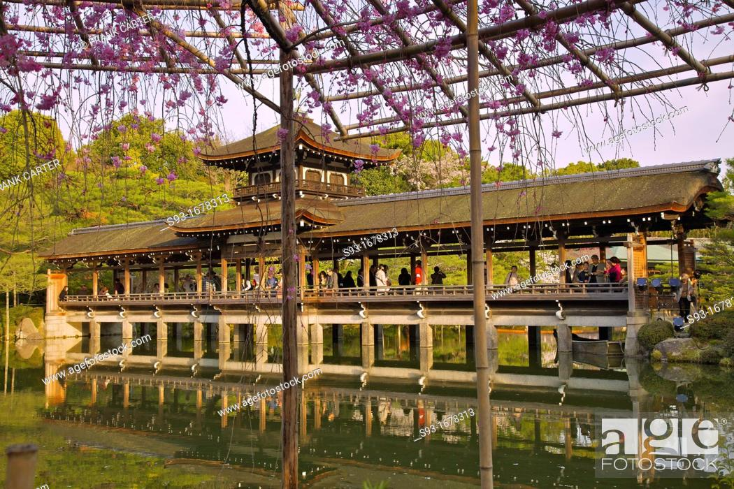 Stock Photo: A view of the pond and covered bridge on the Heian-jingu temple grounds.