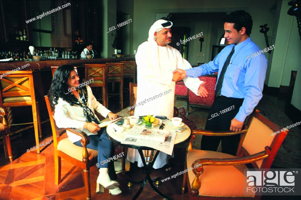 Stock Photo: Arab business meeting in a cafe.